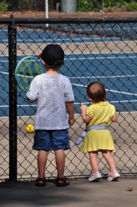 D and K longingly watching their brother play tennis